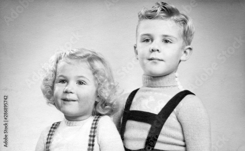 Early 1950s duo portrait of a young boy and girl with blond hair and curls Canvas Print