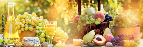 Autumn harvest on table - wine,  grape and a variety of fruits Canvas