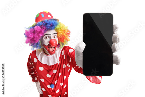 Happy clown showing a mobile phone Canvas Print
