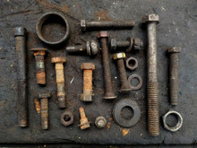 Rusty Bolts, Nuts And Some Steel Tools In An Old Warehouse Workshop