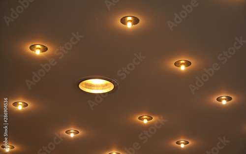 Obraz recessed halogen lamps built in a ceiling - fototapety do salonu