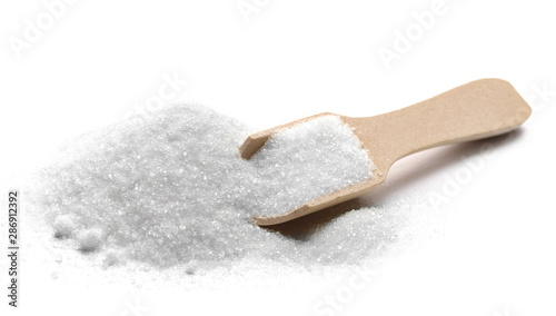Fototapeta Pile sugar crystal with wooden spoon isolated on white