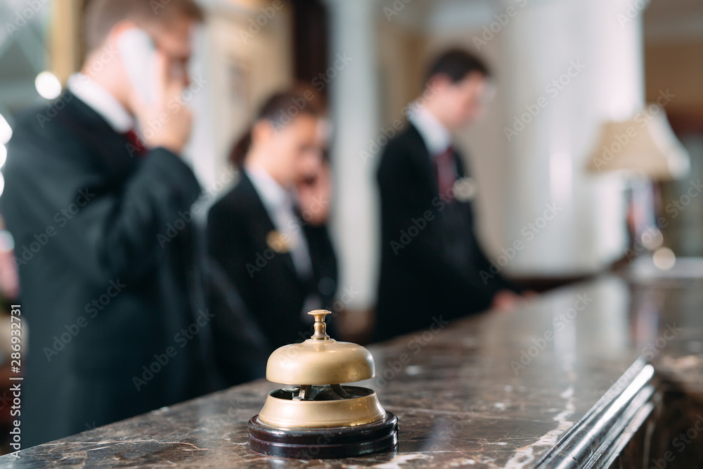 Fototapeta Hotel service bell Concept hotel, travel, room,Modern luxury hotel reception counter desk on background.