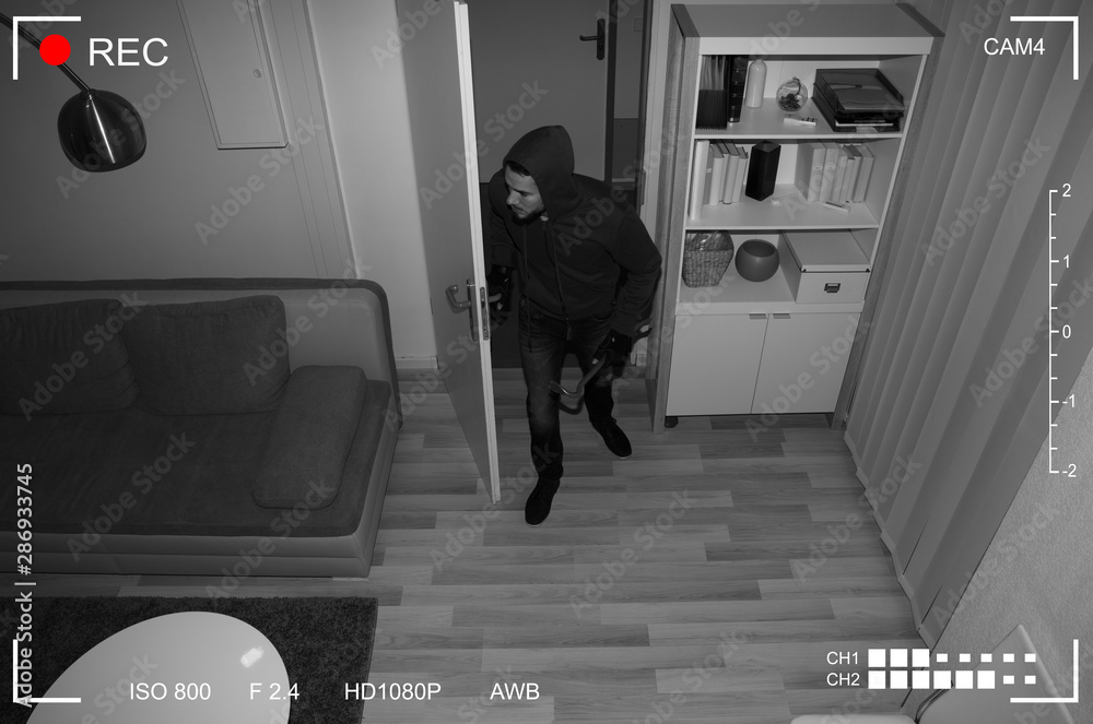 Fototapeta Robber Entering In House