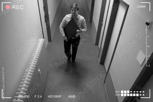 Cuadros en Lienzo  Young Man Stealing Computer Monitor