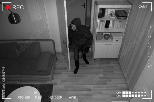 Cuadros en Lienzo  Robber Entering In House