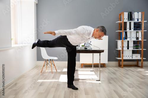Photo sur Toile Les Textures Happy Businessman Stretching