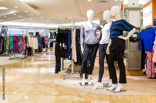 Photo Interior of a fashion and designer clothing store.