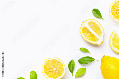 Cuadros en Lienzo  Fresh lemon with slices isolated on white.