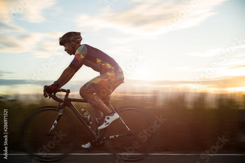 Obraz na plátně Soft focus of man cycling road bike in the morning