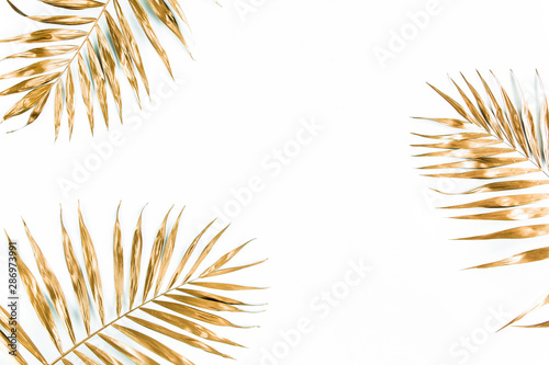 Keuken foto achterwand Bloemen Gold tropical palm leaves on white background. Flat lay, top view minimal concept.