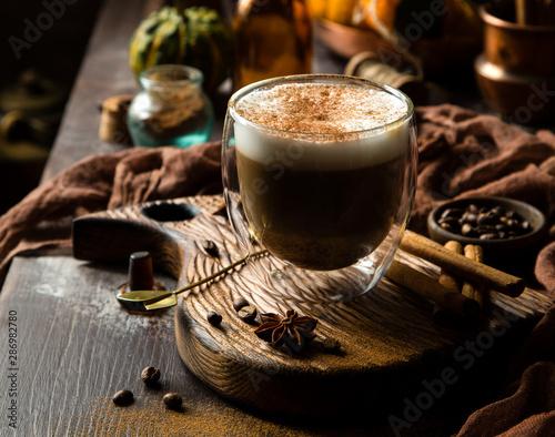 foamy pumpkin spice latte in glass jar on wooden board on rustic brown table Tapéta, Fotótapéta