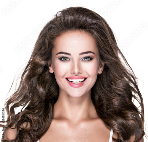 Beautiful laughing woman with long brown hair. - 286984396
