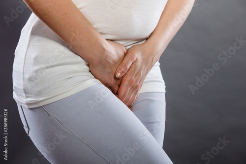 woman with hands holding her crotch Принти на полотні