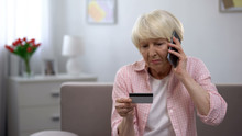 Sad Old Woman With Credit Card...