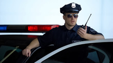 Officer Standing Near Police C...