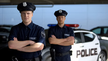 Serious Male Officers Standing...