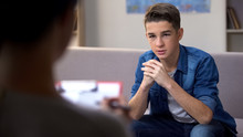 Anxious Teenager Visiting Psychologist For Personal Therapy Session, Problems