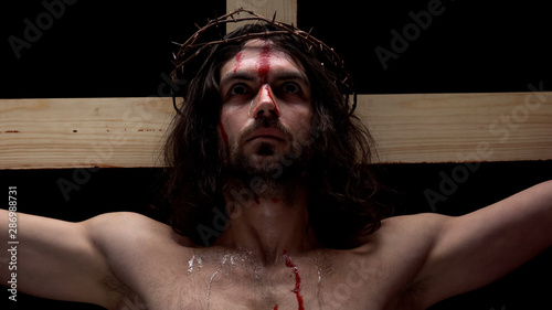 Crucified savior in thorns crown looking up, sins forgiveness religious history Wallpaper Mural