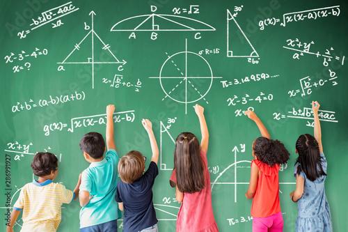 Obraz school children drawing math icon on the chalkboard - fototapety do salonu