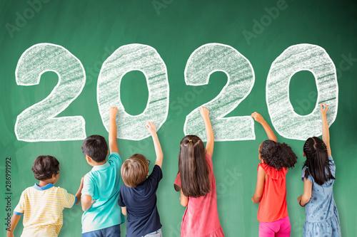 Obraz school children drawing 2020 new year on the chalkboard - fototapety do salonu