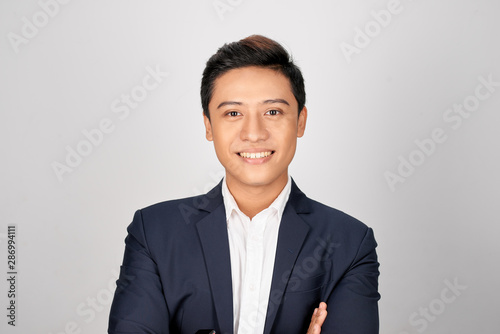 Photo Young good looking asian business man on a white background isolated