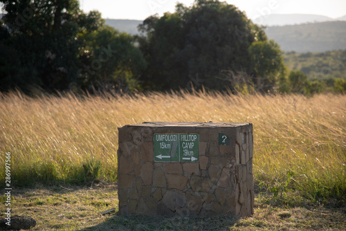 A signpost in the Hluhluwe-iMfolozi game park showing the direction to safari camps.