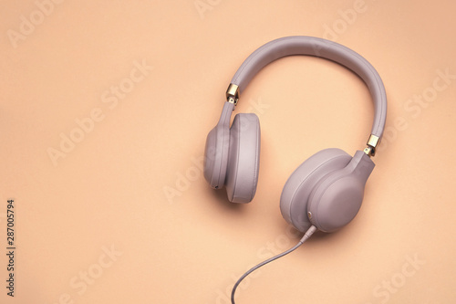 Colored headphones on a colored vintage background Fototapeta