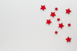 canvas print picture - Christmas composition. Background with red stars top view background with copy space for your text. Flat lay.