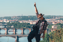 The Man Dancing Break With Happiness. Beautiful View Of The Old City Of Prague, Praha, Tourist Tour In Europe, Vacation. Having Fun. Copy Space