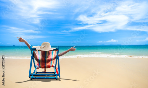 Young women in bikini relax on beach, Vacation concept.