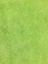 Green Grass Texture Pattern Background Golf Course Turf Lawn From Top View In Bright Yellow Green Color