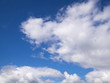 fluffy clouds in the blue summer sky