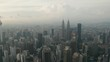 Aerial drone view of Kuala Lumpur city skyline during cloudy day