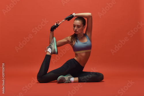 Fototapeta Celebrating beauty and health. Sportswoman is having work out obraz