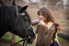 Girl With A Horse On A Ranch On An Autumn Cloudy Day.