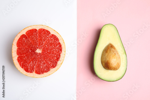 Cut ripe avocado and grapefruit on color background, flat lay - 287046709