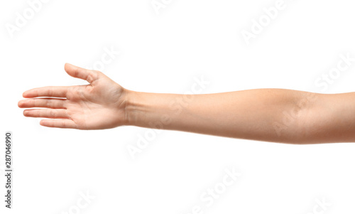 Valokuva  Young woman reaching hand for shake on white background, closeup