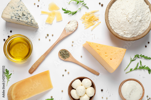 Cuadros en Lienzo  Flat lay composition with fresh ingredients for pizza on white background