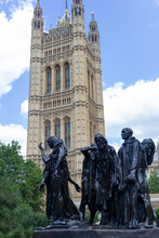 Sculptural Group The Burghers Of Calais, In The Victoria Tower Gardens Westminster Created By Rodin And  House Of Parliament London Detail In Background