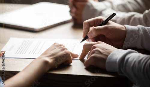 Solicitor pointing at contract showing client where to write signature - 287065506
