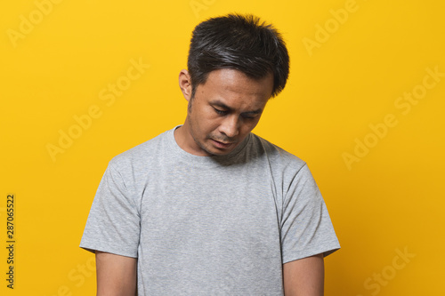 Fényképezés  Depressed asian young man face down feeling failure