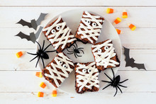 Plate Of Halloween Mummy Brownies, Top View With Decor On A White Wood Background