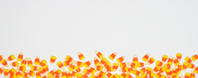 Halloween Candy Corn Border Banner. Top View On A White Background With Copy Space.