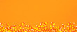 Leinwanddruck Bild - Halloween candy corn long border banner. Top view against an orange background with copy space.