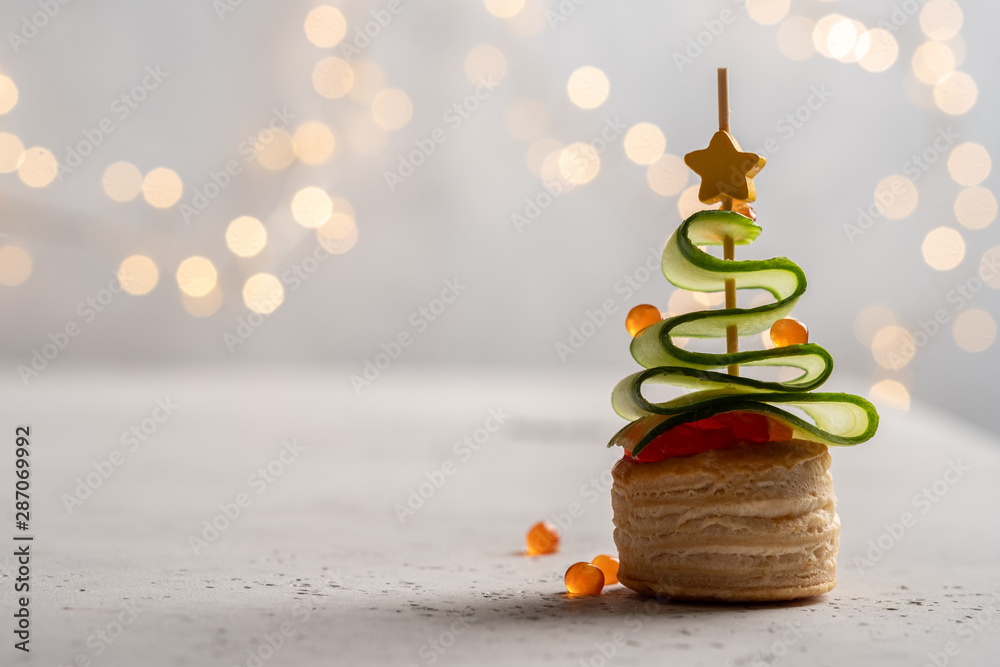 Fototapety, obrazy: Christmas tree canape with cucumber slice, salmon pate and red caviar for festive xmas snack