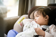 Asian Baby Cute Girl Sleeping Or Relaxing On Car Seat In Heavy Traffic Day In The Morning Time.