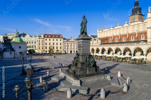 Fotografia, Obraz  Bronze statue of Adam Mickiewicz, Polish national romantic poet and dramatist on Main Market Square in Krakow, Poland