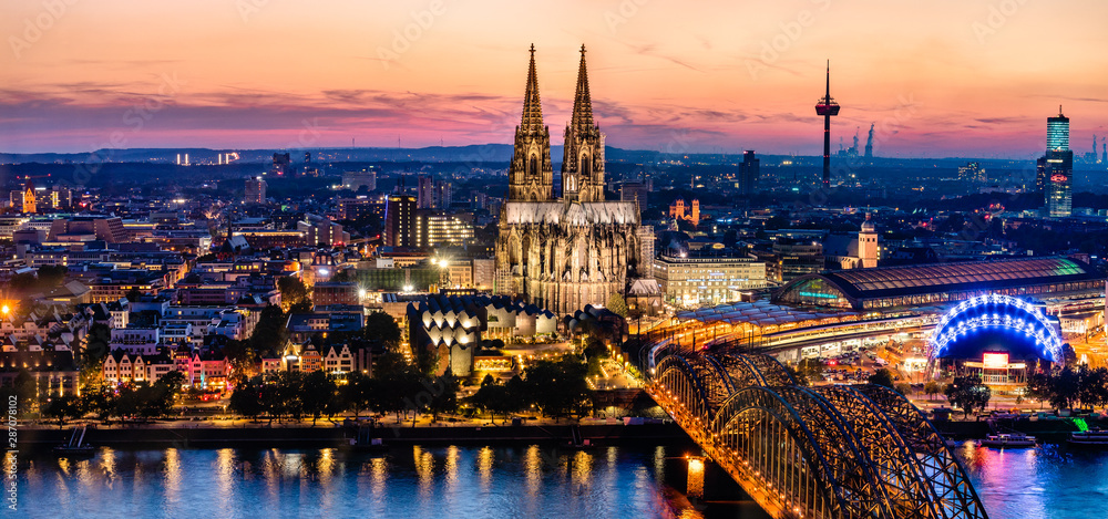 Fototapety, obrazy: Beautiful night landscape of the gothic Cologne cathedral, Hohenzollern Bridge and the River Rhine at sunset and blue hour in Cologne, Germany