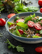 Buckwheat salad with cherry tomatoes, red onion and green vegetables. Healthy diet food